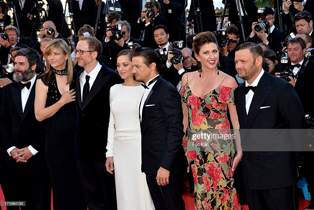 Anthony Katagas, Alexandra Gray, James Gray, Marion Cotillard, Jeremy Renner, a guest and Darius Khondji attend 'The Immigrant' Premiere during the 66th Annual Cannes Film Festival at Grand Theatre Lumiere on May 24, 2013 in Cannes, France.