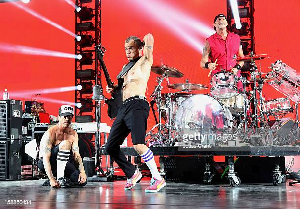 Anthony Kiedis Flea and Chad Smith of The Red Hot Chili Peppers perform on New Year's Eve at The Cosmopolitan of Las Vegas on December 31 2012 in Las...