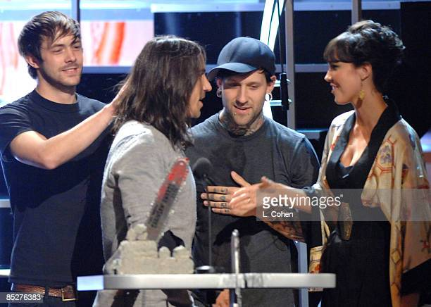 Anthony Kiedis of the Red Hot Chili Peppers accepts the Killer Video award for 'Dani California' from Arielle Kebbel and The Used