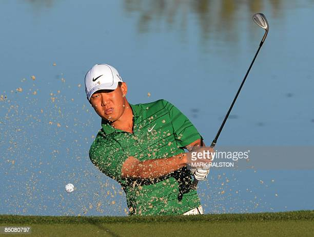 Anthony Kim of the US plays from a sand bunker on the 3rd hole during his matchplay round against Lin WenTang of Taiwan on the first day of the...