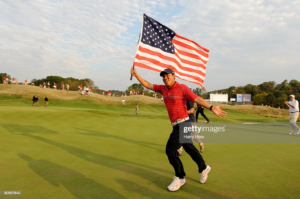 Anthony Kim of the USA celebrates with an American flag after the USA 16 1/2 11 1/2 victory on the final day of the 2008 Ryder Cup at Valhalla Golf...