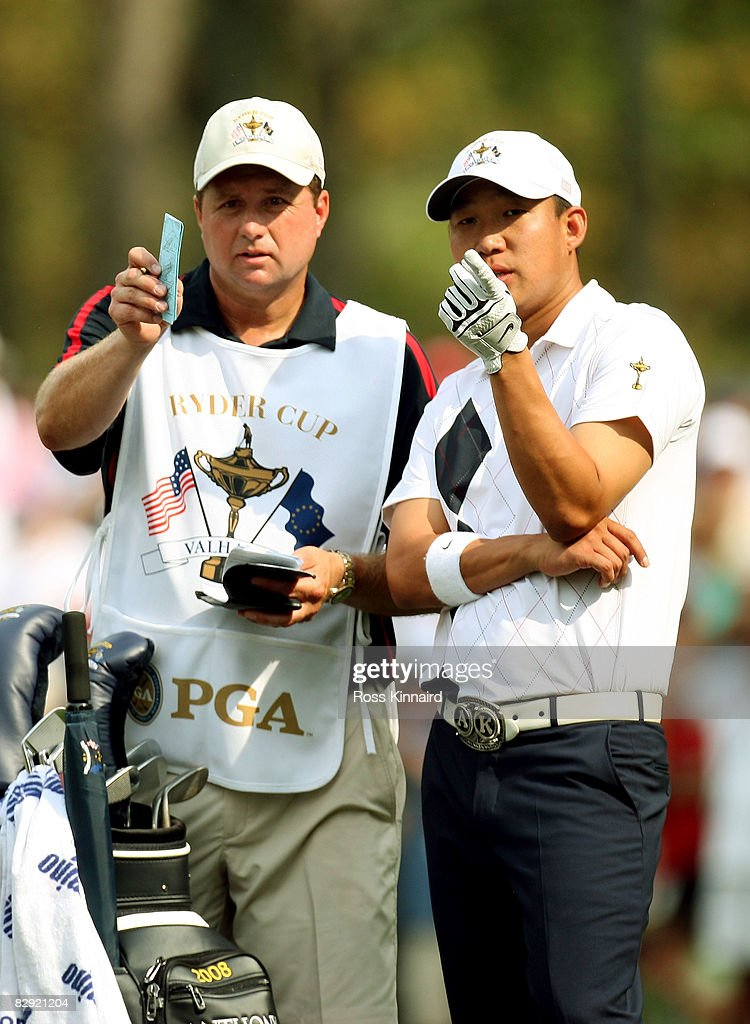 Anthony Kim of the USA team chats with his caddie Eric Larsen during the afternoon four-ball matches on day one of the 2008 Ryder Cup at Valhalla Golf Club on September 19, 2008 in Louisville, Kentucky.