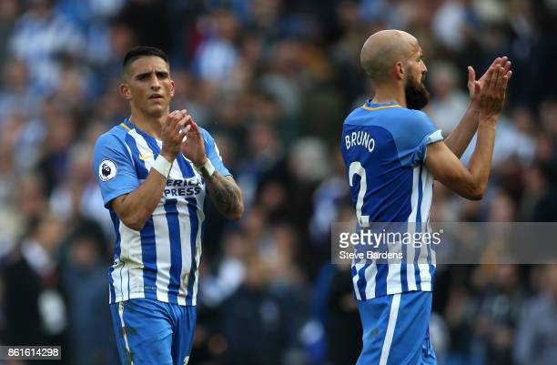 Anthony Knockaert and Bruno Saltor of Brighton and Hove Albion appalud the home fans after the Premier League match between Brighton and Hove Albion...