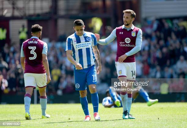 Anthony Knockaert of Brighon is consoled by Conor Hourihane of Aston Villa following the Sky Bet Championship match between Aston Villa and Brighton...