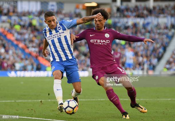 Anthony Knockaert of Brighton and Hove Albion and Leroy Sane of Manchester City battle for possession during the Premier League match between...