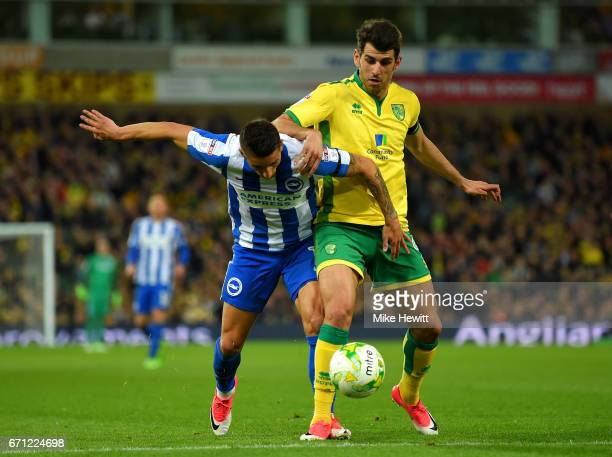 Anthony Knockaert of Brighton and Hove Albion and Nelson Oliveira of Norwich City in action during the Sky Bet Championship match between Norwich...