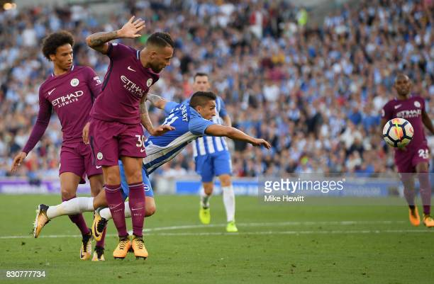 Anthony Knockaert of Brighton and Hove Albion and Nicolas Otamendi of Manchester City clash during the Premier League match between Brighton and Hove...