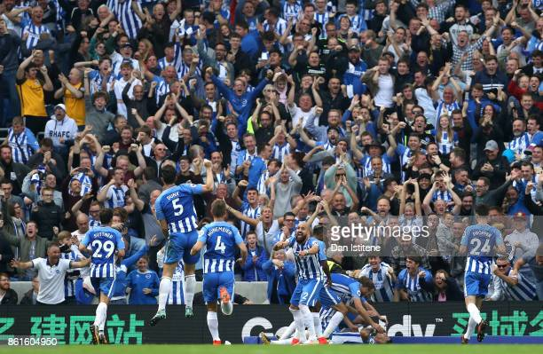 Anthony Knockaert of Brighton and Hove Albion and team mates celebrate scoring the first goal during the Premier League match between Brighton and...