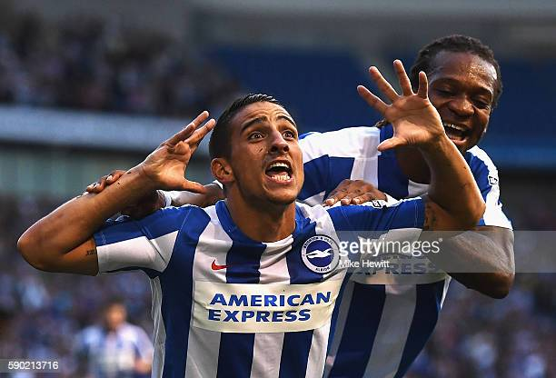 Anthony Knockaert of Brighton and Hove Albion celebrates scoring his sides first goal with team mate Gaetan Bong of Brighton and Hove Albion during...