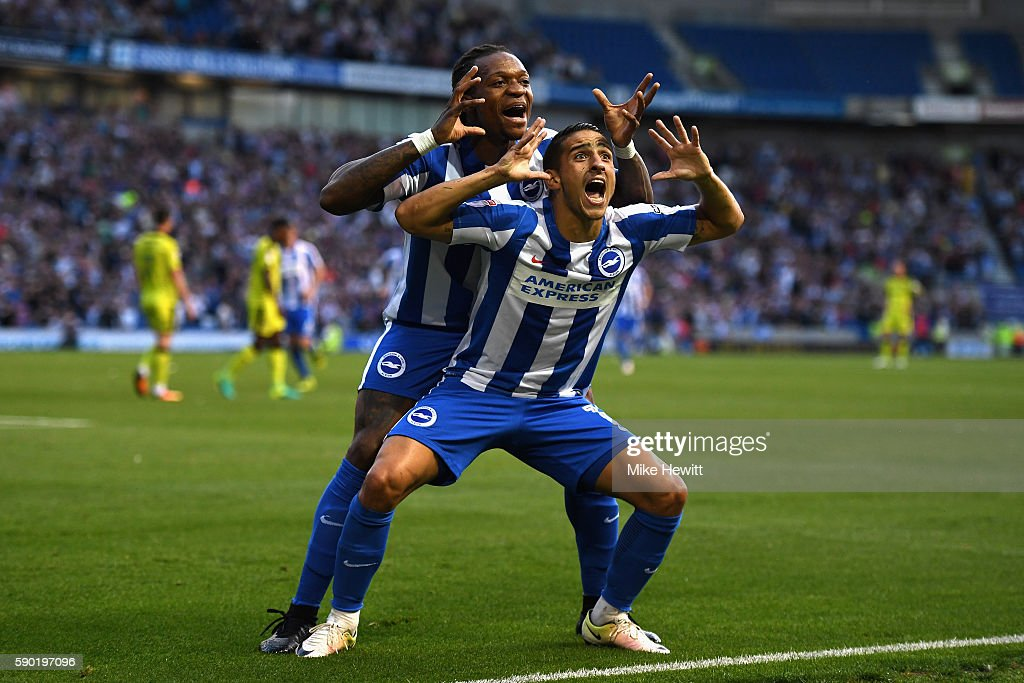 Anthony Knockaert of Brighton and Hove Albion celebrates with team mate Gaetan Bong of Brighton and Hove Albion after scoring his sides first goal...