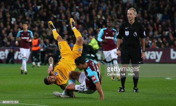 Anthony Knockaert of Brighton and Hove Albion goes overs Javier Hernandez of West Ham United during the Premier League match between West Ham United...