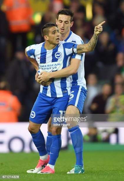 Anthony Knockaert of Brighton and Hove Albion is held back by Lewis Dunk of Brighton and Hove Albion during the Sky Bet Championship match between...