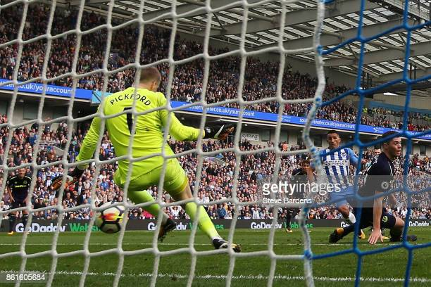 Anthony Knockaert of Brighton and Hove Albion scores the first goal during the Premier League match between Brighton and Hove Albion and Everton at...