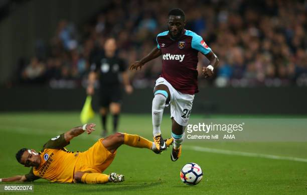 Anthony Knockaert of Brighton and Hove Albion tackles Arthur Masuaku of West Ham United during the Premier League match between West Ham United and...