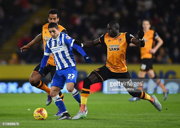 Anthony Knockaert of Brighton battles with Tom Huddlestone and Mo Diame of Hull City during the Sky Bet Championship match between Hull City and...