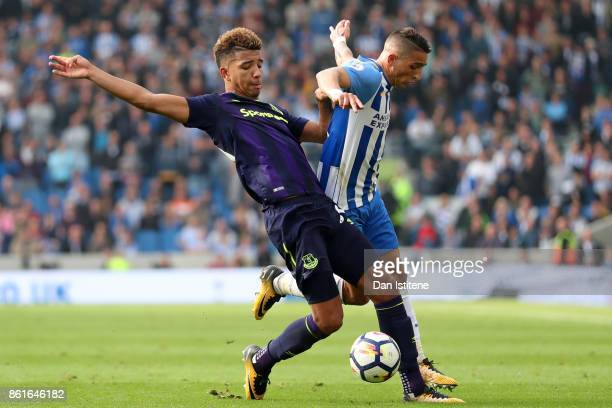 Anthony Knockaert of Brighton Hove Albion battles for the ball with Dominic CalvertLewin of Everton during the Premier League match between Brighton...