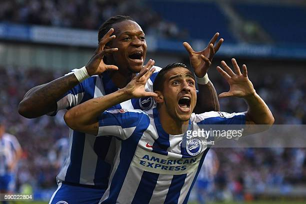 Anthony Knockaert of Brighton Hove Albion celebrates with team mate Gaetan Bong after opening the scoring during the Sky Bet Championship match...