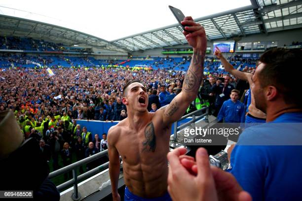 Anthony Knockaert of Brighton Hove Albion celebrates with teammates in the stands after victory in the Sky Bet Championship match between Brighton...