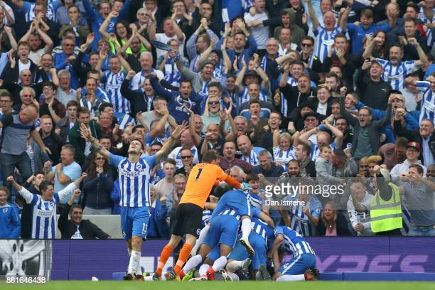 Anthony Knockaert of Brighton Hove Albion celebrates with teammates after scoring the opening goal during the Premier League match between Brighton...