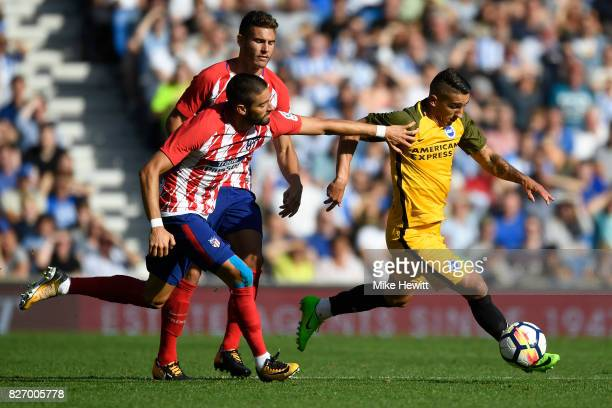 Anthony Knockaert of Brighton is challenged by Yannick Carrasco of Atletico Madrid during a Pre Season Friendly between Brighton Hove Albion and...
