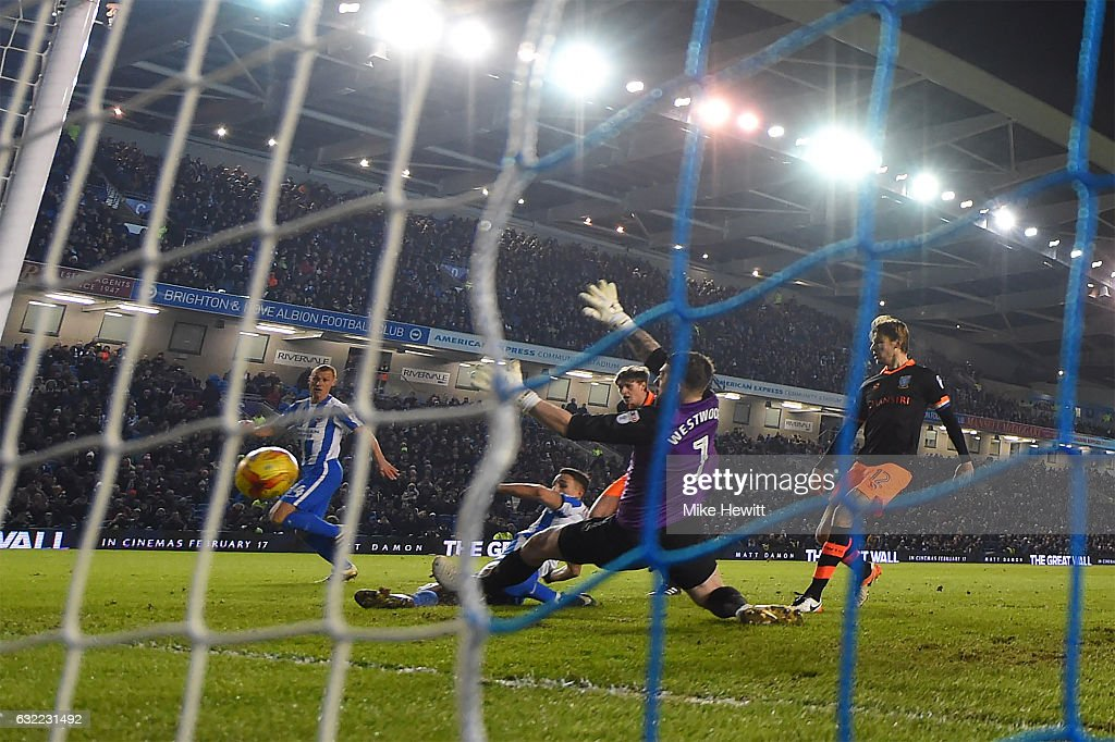 Anthony Knockaert of Brighton slides in to score his second goal past Keiren Westwood of Sheffield Wednesday during the Sky Bet Championship match between Brighton & Hove Albion and Sheffield Wednesday at Amex Stadium on January 20, 2017 in Brighton, England.