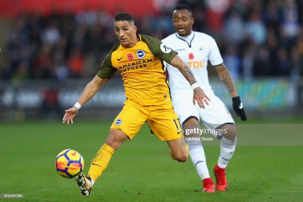 Anthony Knockaert of Brighton tracked by Jordan Ayew of Swansea during the Premier League match between Swansea City and Brighton and Hove Albion at the Liberty Stadium on November 4, 2017 in Swansea, Wales.