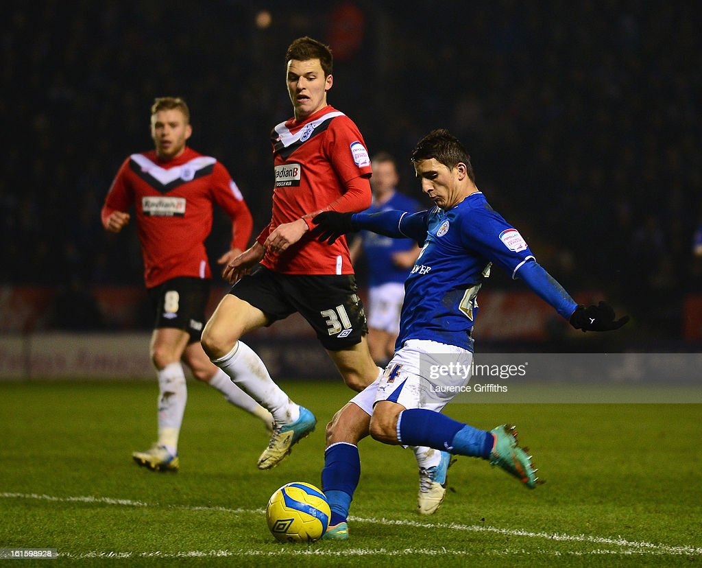 Anthony Knockaert of Leicester City fires in a shot in front of Chris Atkinson of Huddersfield Town during the FA Cup with Budweiser Fourth Round replay match between Leicester City and Huddersfield Town at The King Power Stadium on February 12, 2013 in Leicester, England.