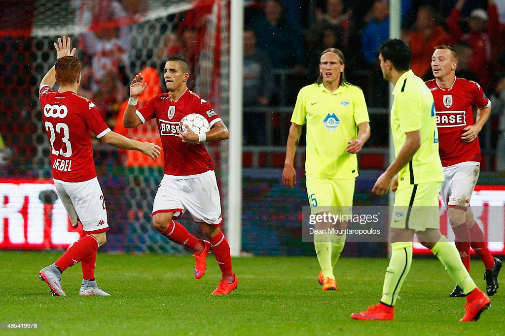 Anthony Knockaert of Standard Liege holds the ball as he celebrates scoring his teams first goal of the game during the UEFA Europa League play off...