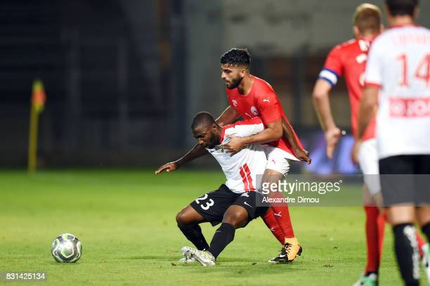 Anthony Koura of Nancy and Umut Bozok of Nimes during the Ligue 2 match between Nimes Olympique and As Nancy Lorraine at Stade des Costieres on...