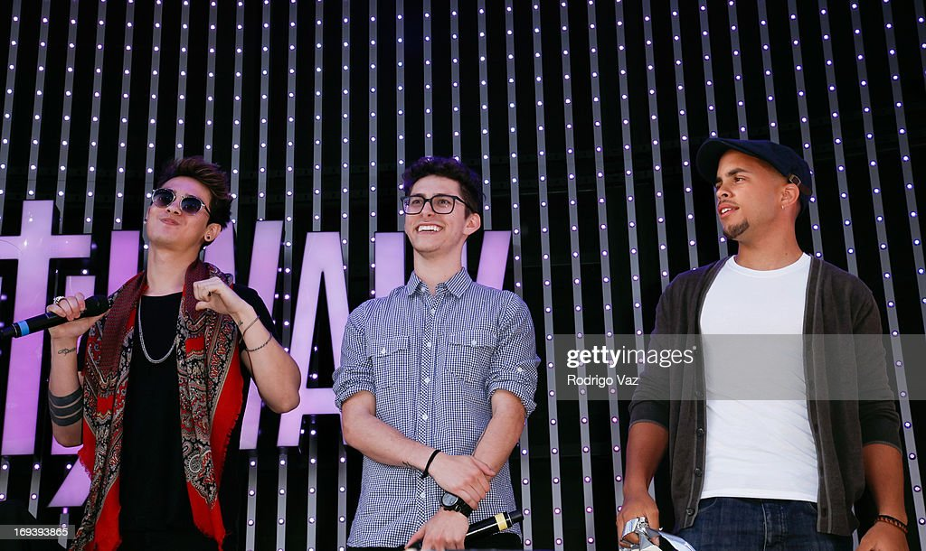 Anthony Ladao, Eric Secharia and Joey Diggs Jr. of Midnight Red perform at Universal CityWalk 20th Anniversary event featuring 8 original cars from 'Fast & The Furious' Movie Franchise at 5 Towers Outdoor Concert Arena on May 23, 2013 in Universal City, California.