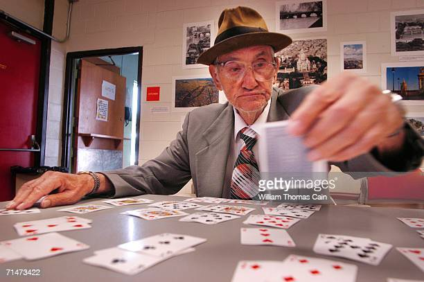 Anthony Lattangio plays solitaire in an air conditioned Philadelphia Senior Center while cooling off from the heat July 18 2006 in Philadelphia...