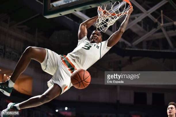 Anthony Lawrence II of the Miami Hurricanes dunks the basketball during the second half against the Navy Midshipmen at The Watsco Center on November...