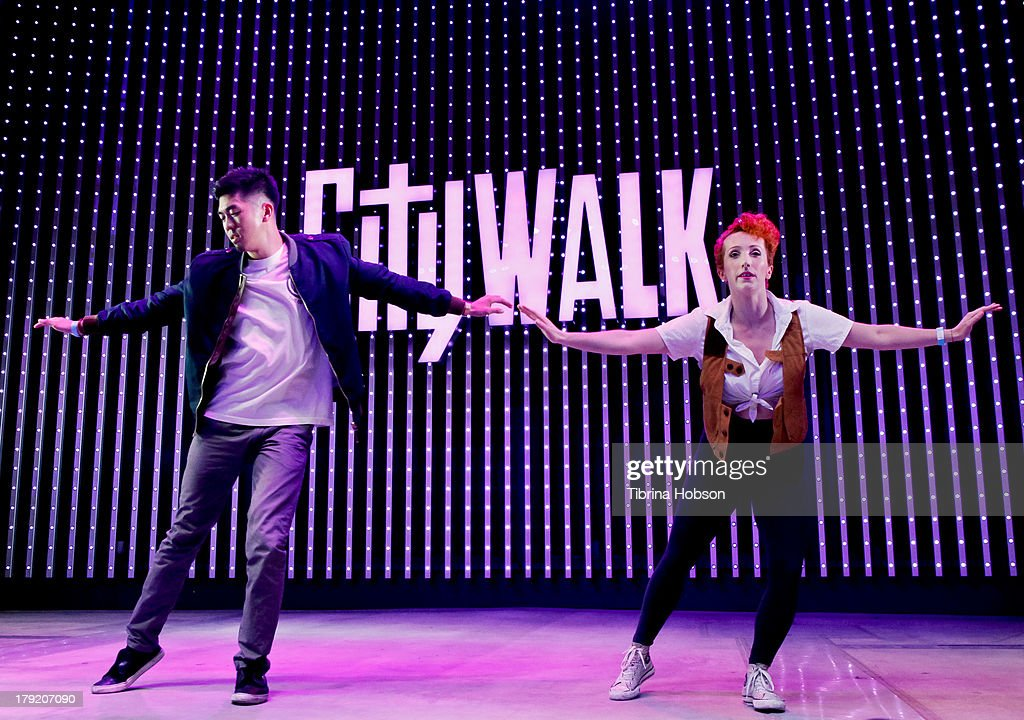 Anthony Lee and Jillian Meyers perform at the Universal CityWalk's 'Music Spotlight Series' World Of Dance at Universal CityWalk on August 31, 2013 in Universal City, California.