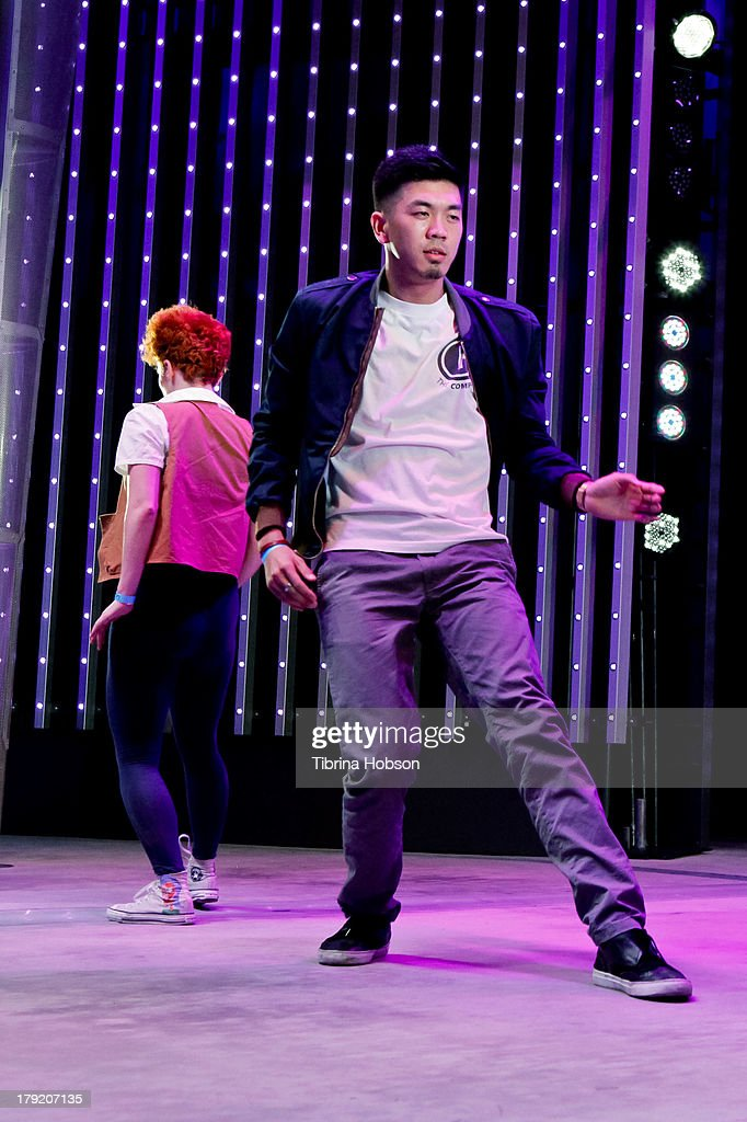 Anthony Lee (R) and Jillian Meyers (L) perform at the Universal CityWalk's 'Music Spotlight Series' World Of Dance at Universal CityWalk on August 31, 2013 in Universal City, California.