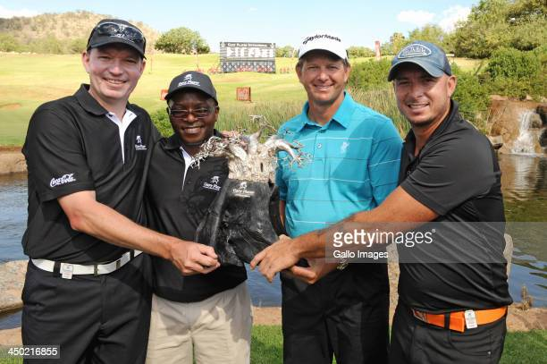 Anthony Leeming Mike Dladla professional golfer Retief Goosen and Herschelle Gibbs of Team Goosen pose with the trophy during the prizegiving...