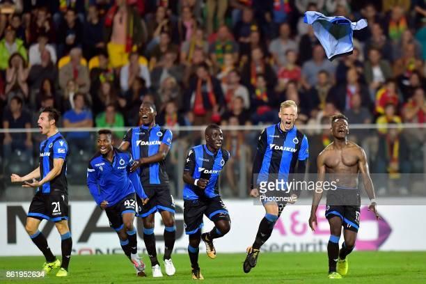 Anthony Limbombe forward of Club Brugge celebrates scoring a goal with Saulo Decarli defender of Club Brugge Marvelous Nakamba midfielder of Club...