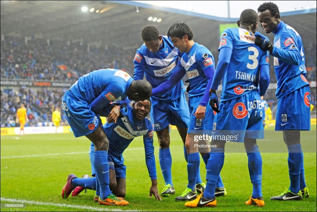 Anthony Limbombe of KRC Genk celebrates scoring a goal with teammates during the Jupiler League match between KRC Genk and Club Brugge KV on February 3, 2013 in Genk, Belgium.