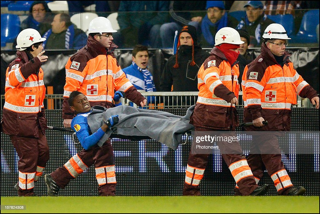 Anthony Limbombe of KRC Genk is carried off the pitch on a stretcher after suffering an injury during the UEFA Europa League group G match between KRC Genk and FC Basel 1893 at the Cristal Arena stadium on December 06, 2012 in Genk, Belgium.
