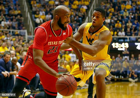 Anthony Livingston of the Texas Tech Red Raiders handles the ball against Sagaba Konate of the West Virginia Mountaineers at the WVU Coliseum on...