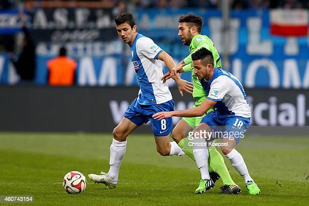 Anthony Losilla of Bochum and Danny Latza of Bochum challenge Patrick Schoenfeld of Erzgebirge Aue during the Second Bundesliga match between VfL...