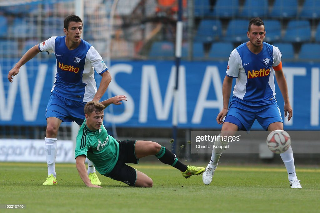 Anthony Losilla of Bochum (L) and Patrick Fabian of Bochum (R) challenge Max Meyer of Schalke (C) during the pre-season friendly match between VfL Bochum and FC Schalke 04 at Rewirpower Stadium on August 5, 2014 in Bochum, Germany.