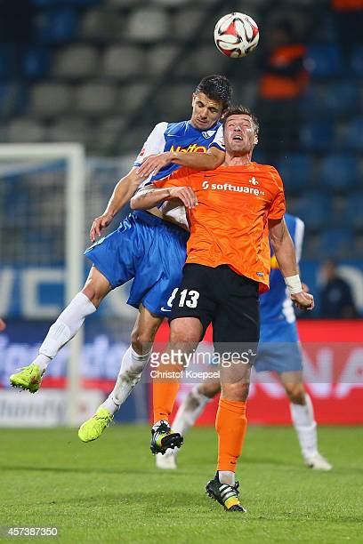 Anthony Losilla of Bochum and Ronny Koenig of Darmstadt 98 go up for a header during the Second Bundesliga match between VfL Bochum and Darmstadt 98...