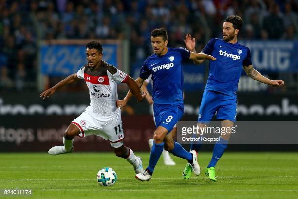 Anthony Losilla of Bochum challenges Sami Allagui of St Pauli during the Second Bundesliga match between VfL Bochum 1848 and FC St Pauli at Vonovia...