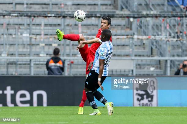Anthony Losilla of Bochum und Romuald Lacazette of 1860 Munich battle for the ball during the Second Bundesliga match between TSV 1860 Muenchen and...