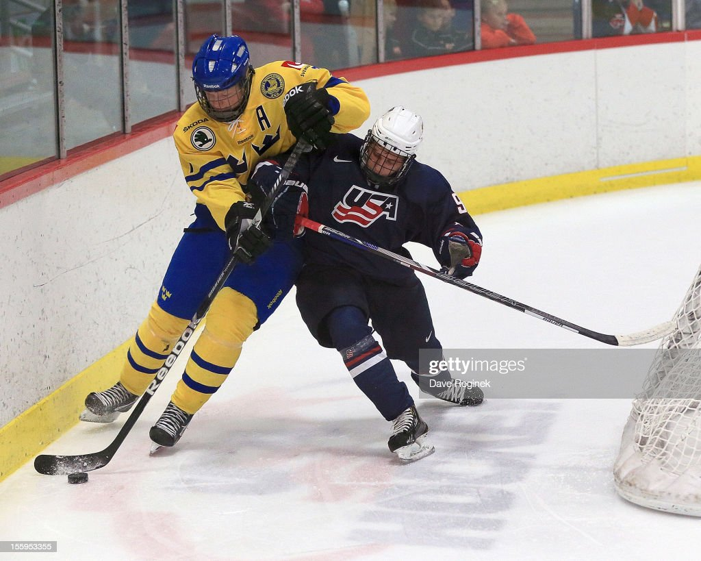 Anthony Louis #9 of the USA battles for the puck against Julius Bergman #7 of Sweden during the U-18 Four Nations Cup tournament on November 9, 2012 at the Ann Arbor Ice Cube in Ann Arbor, Michigan. USA won 5-3.