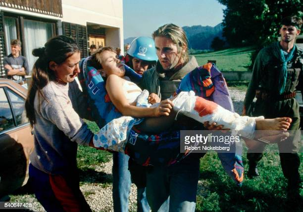 Anthony Loyd tending to eightyearold Alma Causevic wounded during a battle for control of Velika Kladusa part of the Bosnian breakaway republic of...