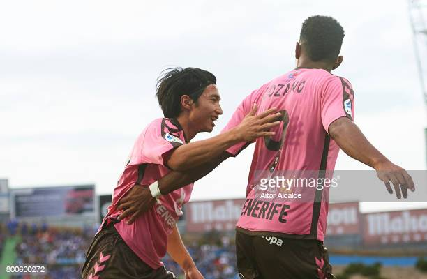 Anthony Lozano of CD Tenerife celebrates after scoring with Gaku Shibasaki of CD Tenerife during La Liga 2 play off round between Getafe and CD...