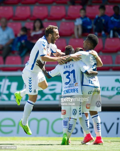 Anthony Lozano of CD Tenerife celebrates with teammates after scoring Tenerife's opening goal in the La Liga Segunda Division match between CD...