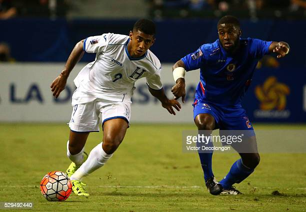 Anthony Lozano of Honduras and Stephane Lambese of Haiti vie for the ball in the second half during the 2015 CONCACAF Olympic Qualifying Group B...