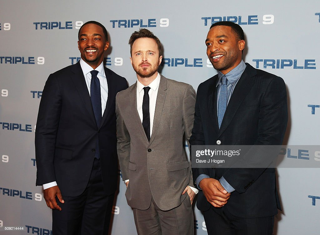 <a gi-track='captionPersonalityLinkClicked' href=/galleries/search?phrase=Anthony+Mackie&family=editorial&specificpeople=206212 ng-click='$event.stopPropagation()'>Anthony Mackie</a>, Aaron Paul and <a gi-track='captionPersonalityLinkClicked' href=/galleries/search?phrase=Chiwetel+Ejiofor&family=editorial&specificpeople=213998 ng-click='$event.stopPropagation()'>Chiwetel Ejiofor</a> attend a special screening of 'Triple 9' at Ham Yard Hotel on February 9, 2016 in London, England.